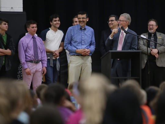 Birmingham Covington School teacher Rick Joseph (center) laughs as State Superintendent Mike Flanagan (right) talks about him after Joseph was named this year's Michigan Teacher of the Year.