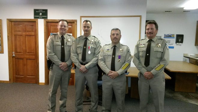 Lyon County sheriff Al McNeil, left, presented awards to three deputies at the May 6 meeting of the Dayton Regional Advisory Board. Pictured from left to right are McNeil, William McDaniel (life saving medal), Rob Hall (Law Enforcement Purple Heart) and Jeffrey Peebles (life saving medal).