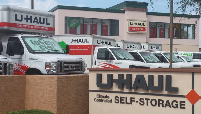 U-Haul trucks in front of a self-storage center.