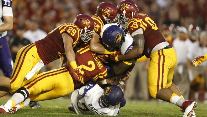 Northern Iowa running back Tyvis Smith (32) gets brought down by a pack of Iowa State defenders Saturday, Sept. 5, 2015, at Jack Trice Stadium in Ames.