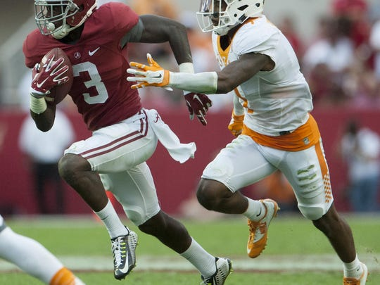 Alabama wide receiver Calvin Ridley tries to elude Tennessee defensive back Cameron Sutton at Bryant-Denny Stadium in Tuscaloosa on Oct. 24, 2015.