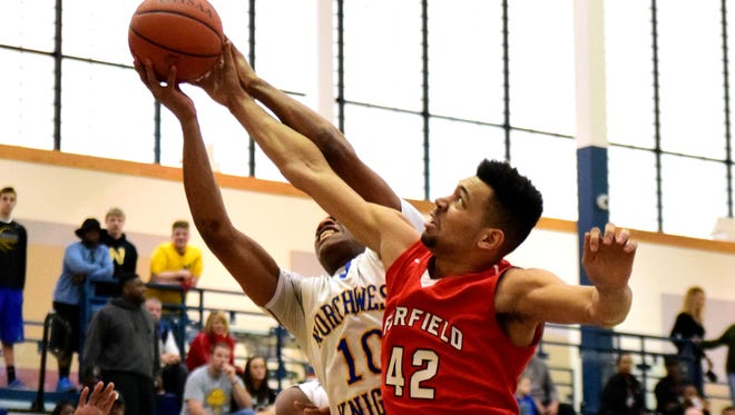 Fairfield's Ben Phillips (42) battles Northwest's George Daniels (10) for a rebound, Feb. 20, 2016.
