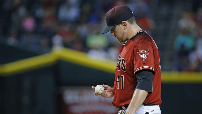 Arizona Diamondbacks relief pitcher Daniel Hudson (41) reacts after giving up a two run home-run to Toronto Blue Jays' Edwin Encarnacion (10) in the 8th inning of their MLB game Wednesday, July 20, 2016 in Phoenix,  Ariz.