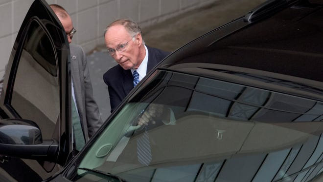 Alabama Governor Robert Bentley exits out of the back of the RSA Union Building in Montgomery, Ala., on Wednesday April 5, 2017 as the Alabama Ethics Commission meets in executive session looking into allegations against him.