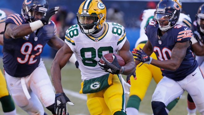 Green Bay Packers running back Ty Montgomery (88) runs past defenders for a long run in the second quarter against the Chicago Bears at Soldier Field Sunday, December 18, 2016.