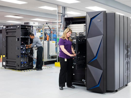In this undated photo, IBM distinguished engineer Karl Casserly (left) and hardware engineer Rhonda Sundlof test the new IBM Z mainframe computer, which is manufactured in Poughkeepsie.