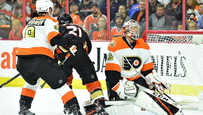 Flyers goalie Steve Mason, right, made 23 saves in the Flyers' home-opening loss.