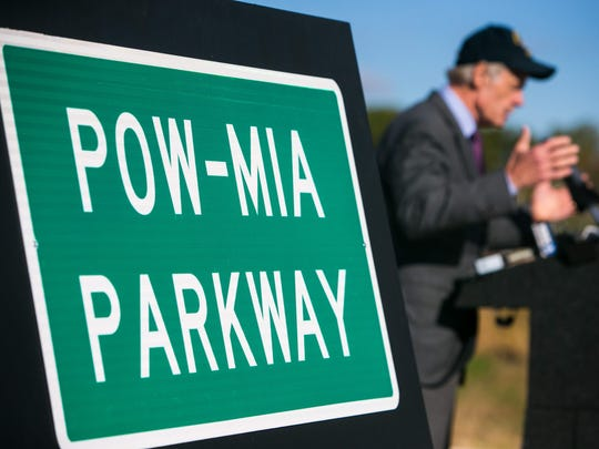 Sen. Tom Carper speaks at DelDot's unveiling ceremony for the naming of the West Dover Connector to the POW-MIA Parkway Monday morning near New Burton Road in Dover.