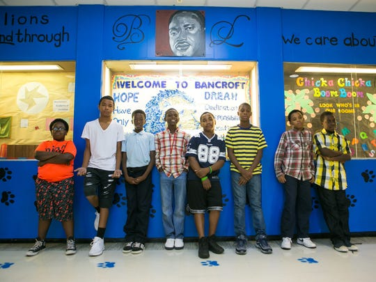 """Shad Boston-Williams (from left), James Thomas, Raymier Hamilton, Javar Curtis-Reeves, Quinnell Anderson, Sanaj Mangun, Raquan Carter and Taurean Wise are some of the students who made the """"My City Needs Something"""" rap video."""