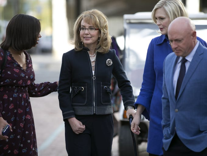 Former  U.S. Rep. Gabrielle Giffords (center) her husband,