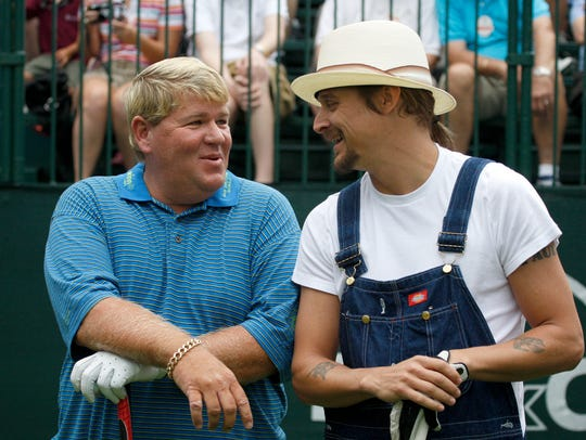 Golfer John Daly, left, and Kid Rock chat before teeing