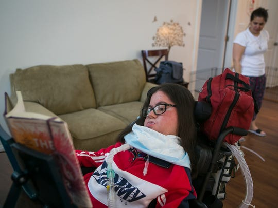 Nicole Albano, who has a rare muscle disorder marked by progressive muscle weakness, likes contemporary fiction. Her family flips the pages of whatever book she is reading for her so she can explore the world from home despite her limited ability to travel.
