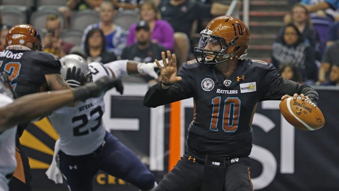 Rattlers' Nick Davila (10) throws a pass under pressure agains the Steel at Talking Stick Resort Arena on April 30, 2016 in Phoenix, Ariz.
