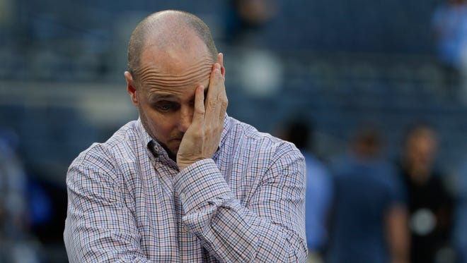 New York Yankees general manager Brian Cashman watches batting practice before a baseball game against the Kansas City Royals, Thursday, May 12, 2016, in, New York.