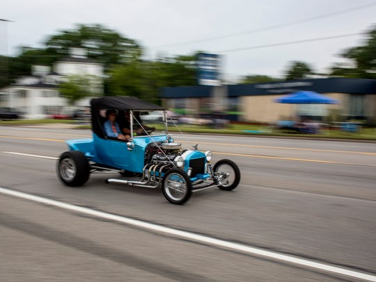 A car cruises during Cruise Night Friday, June 23,