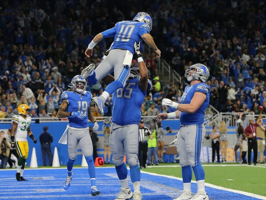 DETROIT, MI - DECEMBER 29: David Blough #10 of the Detroit Lions celebrates his first quarter touchdown catch with Tyrell Crosby #65 of the Detroit Lions against the Green Bay Packers  at Ford Field on December 29, 2019 in Detroit, Michigan. (Photo by Rey Del Rio/Getty Images)
