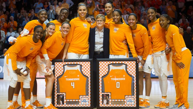 The Lady Vol basketball team poses for a photo with head coach Holly Warlick and seniors Schaquilla Nunn (4) and Jordan Reynolds (0) before the game against Florida at Thompson-Boling Arena on Thursday, Feb. 23, 2017. Tennessee defeated Florida 74-70.