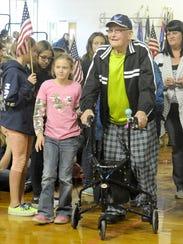 Sixth-grader Ariana Mercks escorts her great-grandfather,
