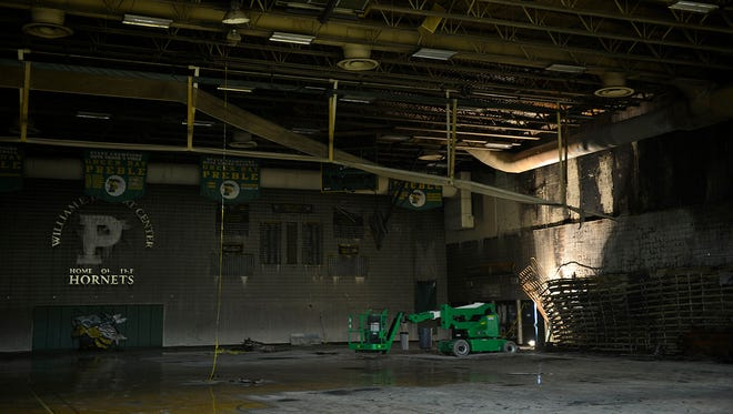 Fire damage inside the main gymnasium at Green Bay Preble High School. Fire crews were called to the school early Friday to extinguish a fire in the bleachers in the gymnasium. Smoke damage was present throughout the building.