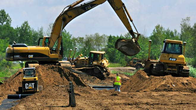 Construction continues on Stearns County Road 4 between Quail Road and 352nd Street Wednesday to widen the road and strengthen the shoulders through a swamp area. Stearns County is discussing the possibility of adopting a countywide sales tax to fund transportation projects.