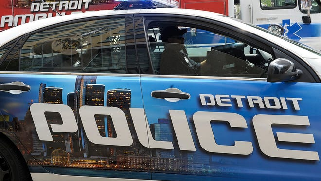 Officer Roger Salcedo of the Central District sits in a new patrol car