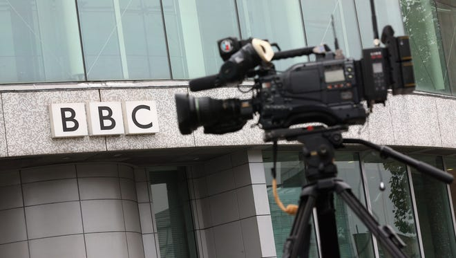 A television camera outside is positioned outside the BBC Television Centre on Oct. 22, 2012, in London.