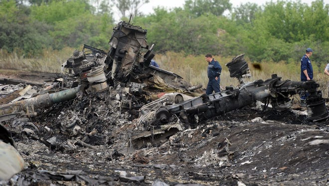 Rescuers at the site of the crash of a Malaysian airliner carrying 298 people from Amsterdam to Kuala Lumpur in rebel-held east Ukraine, Friday.