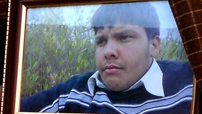 An undated framed photograph shows 17-year-old Pakistani student Aitzaz Hasan, who residents and police say died this week while trying to stop a suicide bomber who was targeting his school in a remote village in Hangu, Pakistan.