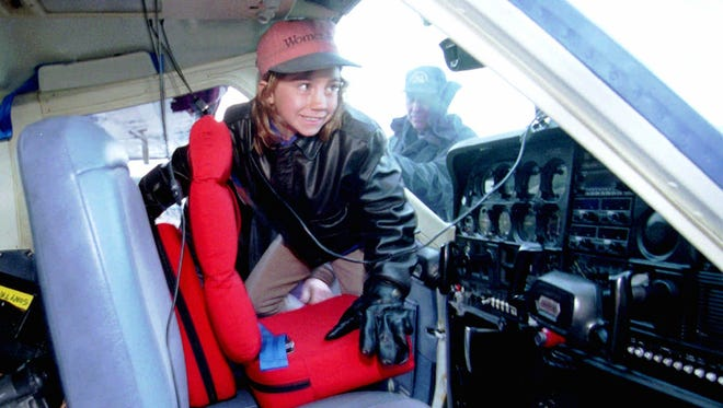 This April 10, 1996 file photo shows 7-year-old Jessica Dubroff adjusting the special cushions allowing her to see above the instrument panels before taking off on the first leg of her cross-continent journey from Half Moon Bay, Calif. Dubroff, flying with her father and a flight instructor crashed after taking off from the Chetenne, Wyo., airport April 11, 1996. Two recent plane crashes that killed teenage pilots start anew debate over how young is too young to fly. Some pilots say teens don't have the maturity to deal with unforeseen difficulties, while other say training matters more than age and a familiarity with video games allows many young people to learn faster than an older flight student. (AP Photo/Lacy Atkins, File)