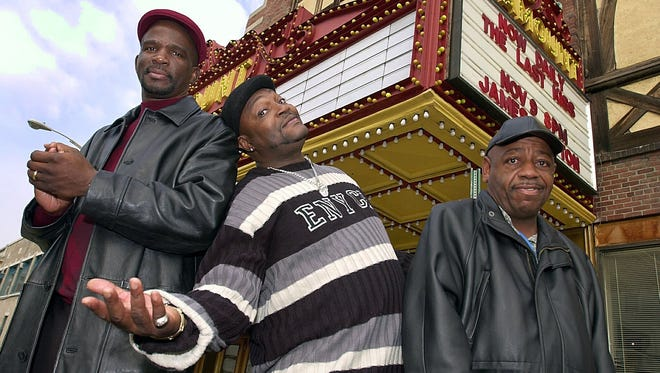 """In 2002, James """"Uncle Jimmy Mack"""" McNair staged a benefit concert at the then-Paramount Center for the Arts to feed the hungry with Brothers Production members Glenn Cook, left, and Wesley Bullock, right. On Thursday, McNair's funeral will be held in the Brown Street theater."""
