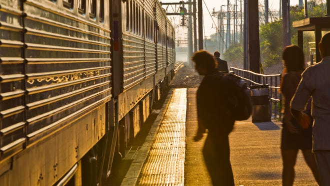 Passengers board the 6:46 a.m. northbound SEPTA train in Newark on June 21, 2012.