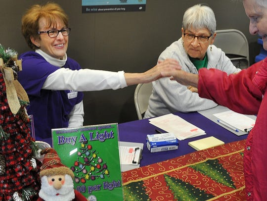 In this 2017 file photo, Hospice of Wichita Falls volunteers Rhonda Hester, right, and Shirley Visintainer greet customers as they enter United Market Street while accepting donations for the Hospice Tree of Lights. Each $10 donation will light-a-light on the Hospice tree located at the top of the Chase Bank building located at the corner of Kemp Blvd. at Elliot St. Donations can be made at Market Street and at the Hospice building on Johnson Road.