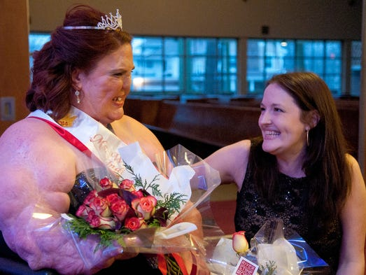 Ruth Smith receives congratulations from Angela Knartzer, wife of judge Kevin Knartzer, for being crowned Ms. Wheelchair Indiana at the Basile Opera Center, Saturday, March 29, 2014.