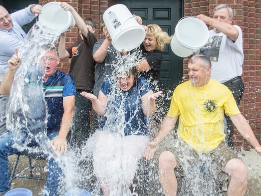 Members of the Mansfield Playhouse Doug Wertz, artistic director; Tammy Wertz, theater manager and Steve Zigmund, board president are doused with buckets of ice water as part of the ALS (Lou Gehrig's Disease) challenge to raise money for the charity.