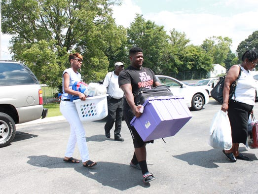Lane College students and their family members move belongings into dorms Saturday at Lane College.