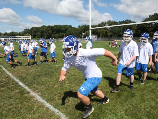 The Pearl River football team works out during the first day of practice at Pearl River High School Aug. 18, 2014 .
