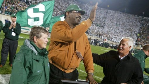 Bubba Smith waves to the crowd during his number-retirement ceremony at Michigan State on Sept. 23, 2006.