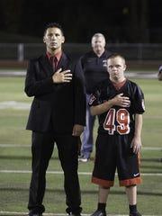 Woodbridge High School Principal Glenn Lottmann stands