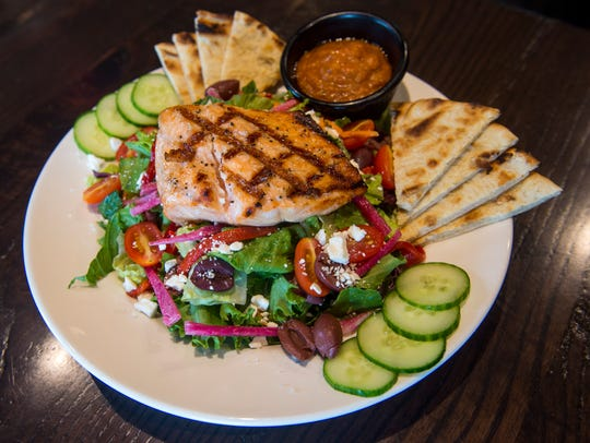 A Mediterranean salad with grilled salmon at The Local