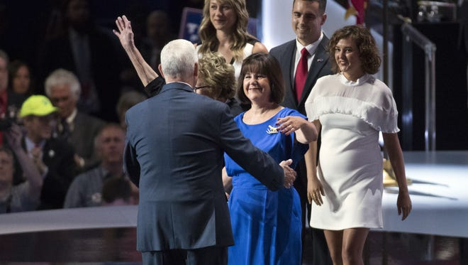 Karen Pence walks out to greet her husband, Republican vice presidential candidate Gov. Mike Pence, with other family members after he spoke during the Republican National Convention, Wednesday, July 20, 2016, in Cleveland.
