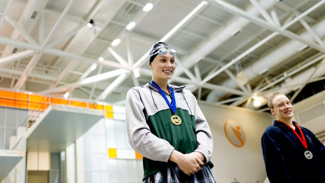 Harpeth Hall's Alex Walsh wins first place for setting a new national independent school record in the 100-yard breaststroke during the 2018 TISCA Tennessee High School Championship at Allan Jones Intercollegiate Aquatic Center in Knoxville, Tennessee on Saturday, February 10, 2018.