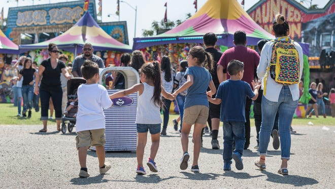 Families and students flooded the midway of the Tulare County Fair on Wednesday, September 13, 2017.