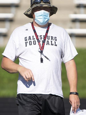 Galesburg High School head football coach Michael Washabaugh guides a drill during workouts on Tuesday, July 28, 2020.
