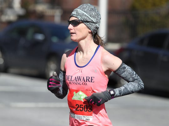 Overall women's division winner Elizabeth Swierzbinski from Wilmington prepares to cross the finish line with a time of 1:23:59 during the 55th annual Caesar Rodney Half Marathon for the American Lung Association Sunday in Wilmington.