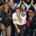 Beyoncé, Coldplay singer Chris Martin and Bruno Mars perform Sunday during halftime at the Super Bowl. Coldplay's latest music video has triggered a debate over its portrayal of India.