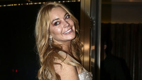 Lindsay Lohan attends the opening of her Lohan Nightclub
