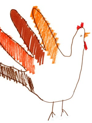 A child's drawing of a traditional hand turkey for Thanksgiving using markers and crayons in orange and brown autumn colors