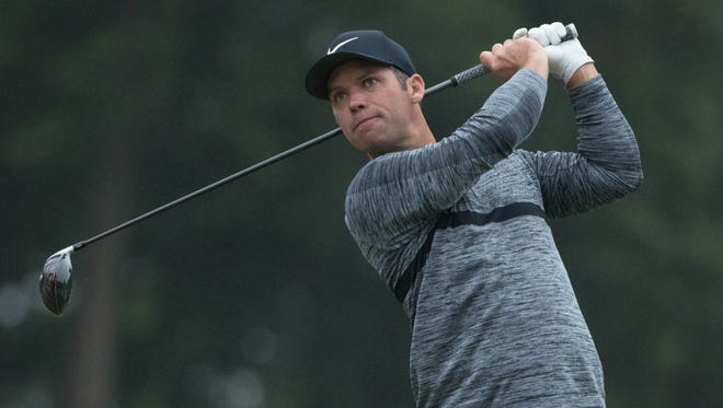Paul Casey plays his shot from the 18th tee during the third round of the Travelers Championship at TPC River Highlands.