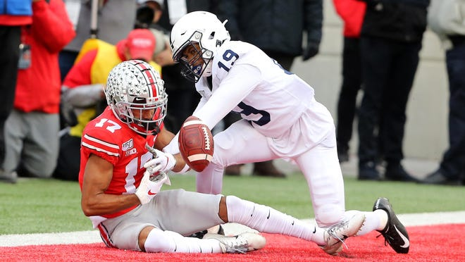 Penn State's Trent Gordon breaks up a pass to Ohio State wide receiver Chris Olave during last year's game. Gordon played in 10 games last season at cornerback but has  moved to safety for this season. He played safety at Manvel High School in Texas.
