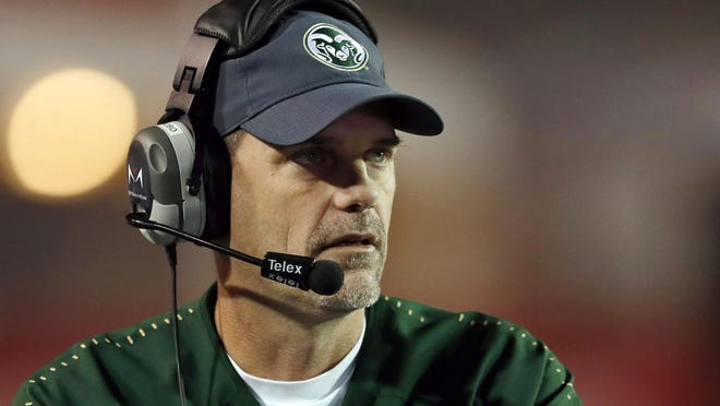FILE - In this Oct. 11, 2019, file photo, Colorado State coach Mike Bobo watches from the sideline during the second half of an NCAA college football game against New Mexico in Albuquerque, N.M. First-year South Carolina assistant Mike Bobo said Thursday, Aug. 20, 2020, he was offended by allegations that anyone on his former Colorado State staff or team say they were abused or treated with racial insensitivity. Bobo had been Colorado State's coach the past five years before getting hired at South Carolina last December.